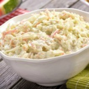 Close-up of a bowl of coleslaw on a picnic table