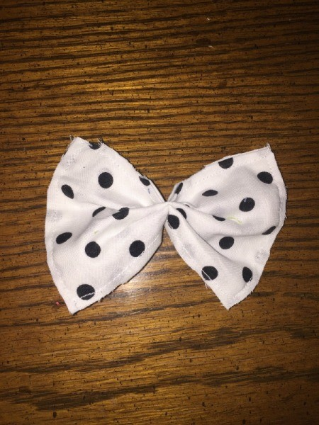 white fabric bow with black polka dots