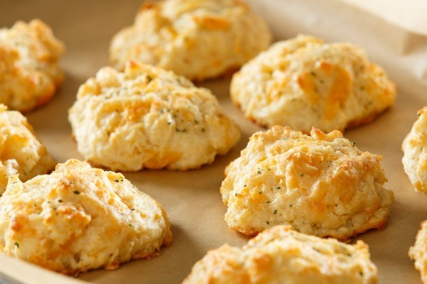 Baked cheese Biscuits on a stoneware tray