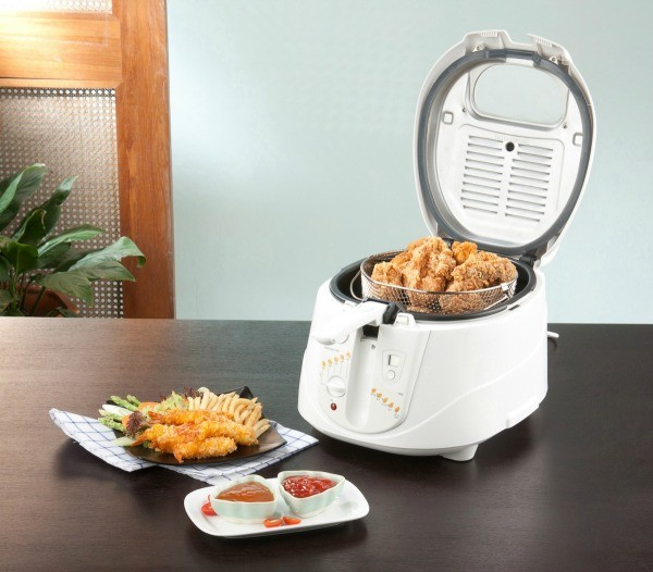 Home Deep Fryer with Fried chicken and chicken and sauces on table