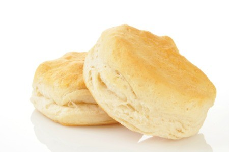 Two biscuits on a white background