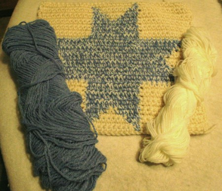 crochet square with blue and white yard