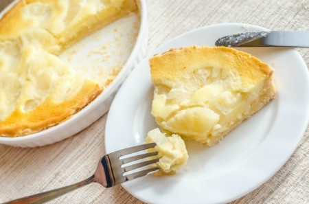 Slice of Pineapple cheesecake with fork.