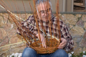 Senior man weaving a basket