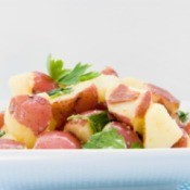Red Potato Salad in a white dish