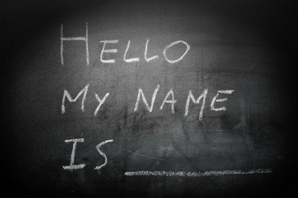 "Chalkboard with ""Hello My Name Is _____"" written on it."