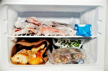 Contents of a freezer compartment from a refrigerator with the freezer on top