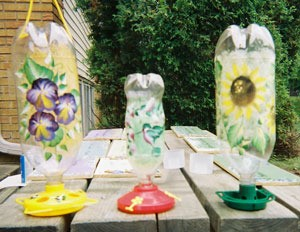 Decoupaged Pop Bottle Bird Feeders