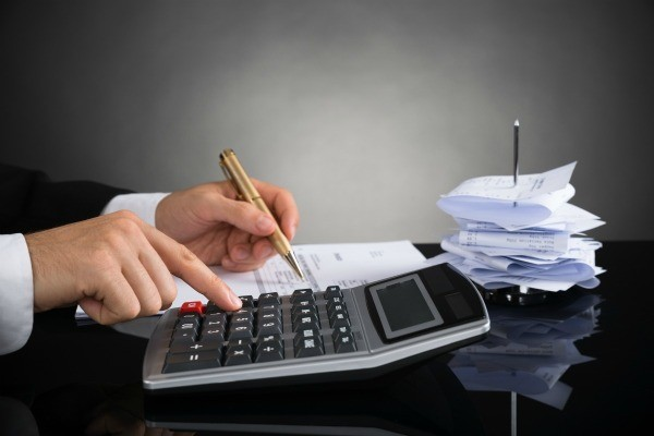 Using calculator to balance checkbook with a large stack of receipts