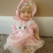 small doll in pink dress