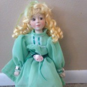 blonde haired doll with aqua dress