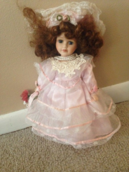 doll wearing a pink dress