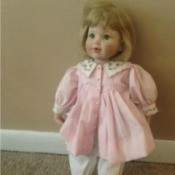 doll in pink dress and bloomers
