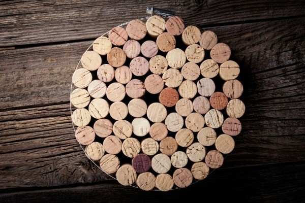 Trivet (hot pad) made from wine corks inside metal hoop