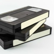 Three blank VHS tapes stacked against a white surface