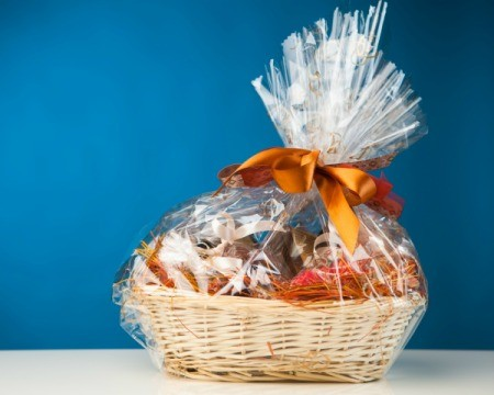 Gift Basket in cellophane against a blue background