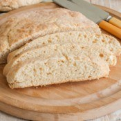 Yeast free quick bread on round cutting board