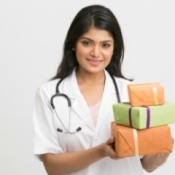 Nurse with stethoscope holding three orange and green wrapped presents