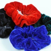Pile of four hair scrunchies in different colors