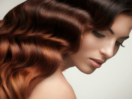Woman with shiny soft hair set in waves