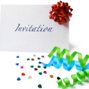 Blank Invitation surrounded by ribbons on confetti