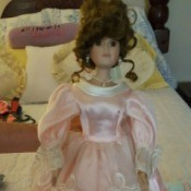 doll with undo hair style and long formal pink gown