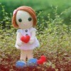 Crocheted Doll holding a heart