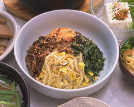 Korean food spread centered on meal in a bowl