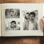 Looking at a photo album showing pictures of a man and his family