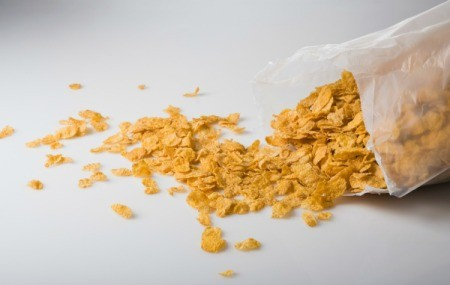 Bag of flake breakfast cereal spilling out on counter