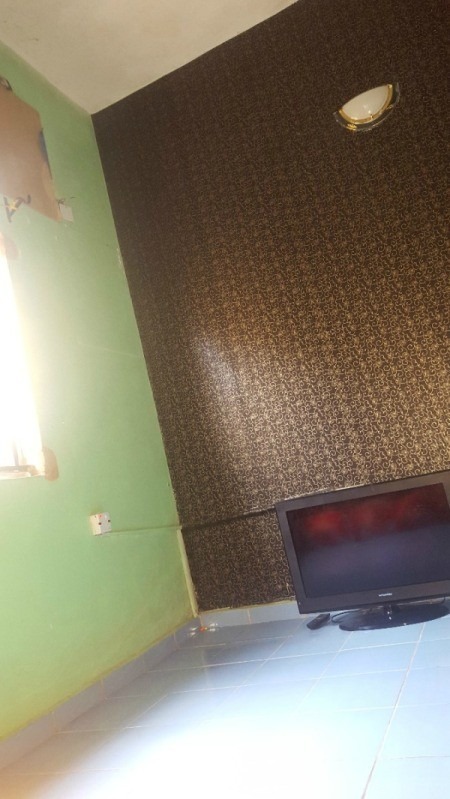 bedroom painted and papered walls