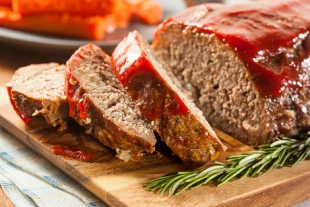 Meatloaf with several slices ready to be served