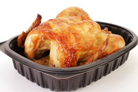 Rotisserie chicken in a plastic to go box