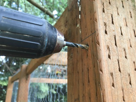 Drilling a hole for the kayak hanging hardware.