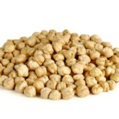 Pile of dried garbanzo beans on white background