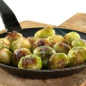 Browned Brussels Sprouts in a black skillet