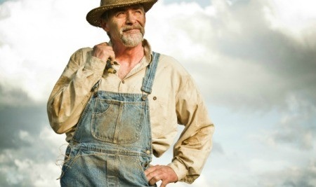 Farmer wearing dirty overalls