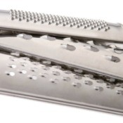 Stack of three cheese metal cheese graters with different hole sizes