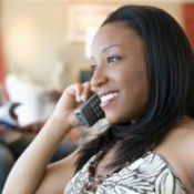 Woman talking on wireless telephone
