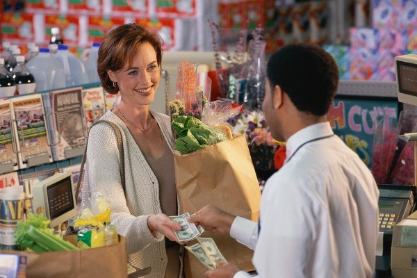Woman receiving change at the grocery store