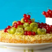 Pie topped with gooseberries and honey