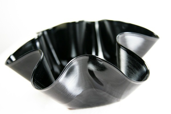 Bowl made from a black vinyl record