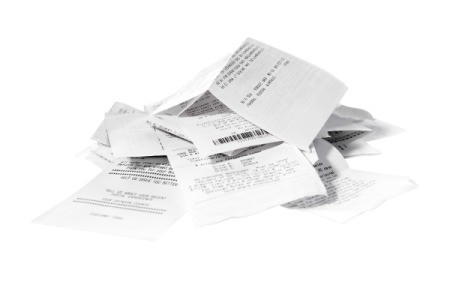 Pile of receipts on a white background