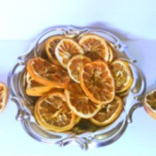 dish of grapefruit potpourri with slices for hanging on the side