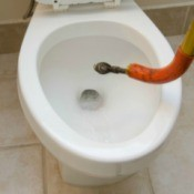 Snaking a toilet