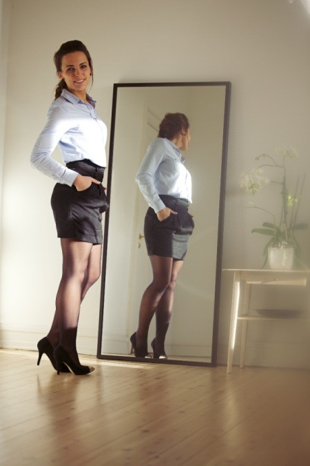 Confident Woman in front of mirror