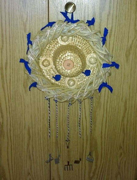 finished wreath hanging from closet knob
