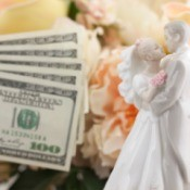 Bride and Groom porcelin decoration next to hundred dollar bills