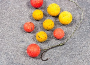 Carp fish hook with orange and yellow bait balls