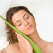 Woman hugging an aloe frond